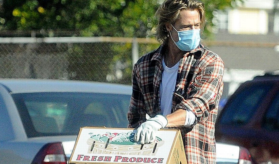 brad pitt volunteers delivering